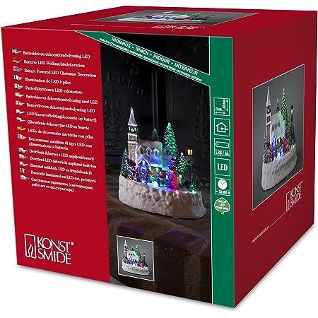 Konstsmide 3496-000 - Figura decorativa de casa y niños jugando (con iluminación led y movimiento, 10 diodos, funciona con 3 pilas AA de 1,5V no incluidas)