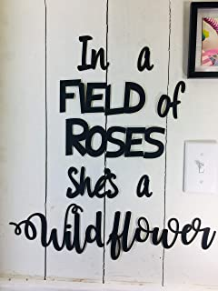 In a Field of Roses She's a Wildflower -this is NOT Vinyl Decal or Peel Stick - easily Tak-it-Up with Plasti-Tak provided Removable Paintable Art Wall Décor Gift Quotes sayings for Home College Dorm
