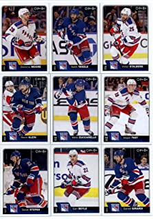 2016-17 O-Pee-Chee Hockey New York Rangers Team Set of 20 Cards in Protective Snap Case: J.T. Miller(#11), Kevin Hayes(#34), Chris Kreider(#60), Derick Brassard(#75), Marc Staal(#93), Ryan McDonagh(#118), Rick Nash(#142), Oscar Lindberg(#164), Antti Raanta(#197), Henrik Lundqvist(#213), Eric Staal(#232), Derek Stepan(#278), Dan Boyle(#349), Daniel Girardi(#384), Kevin Klein(#395), Mats Zuccarello(#404), Jesper Fast(#422), Dominic Moore(#435), Keith Yandle(#457), Viktor Stalberg(#517)