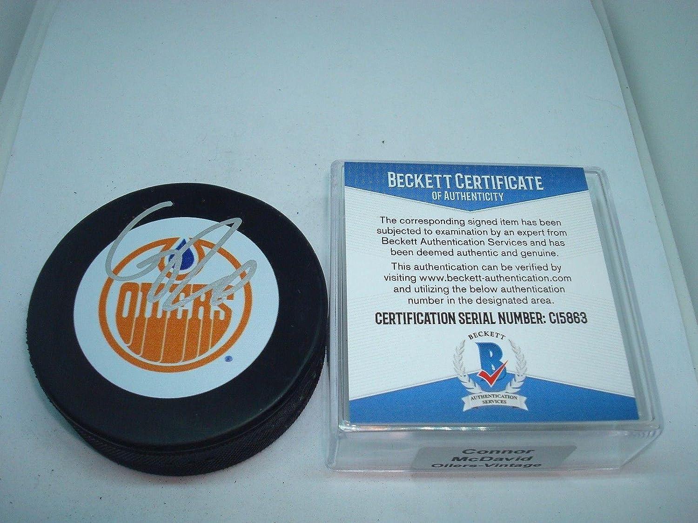 Signed Connor McDavid Hockey Puck  Beckett BAS COA 1A  Beckett Authentication  Autographed NHL Pucks