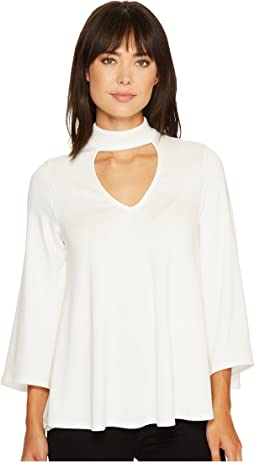 0867be34e365 13. Karen Kane. Mock Neck Flare Sleeve Top
