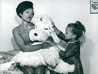 Vintage photo of Eartha Kitt with her daughter Kitt in her home in California