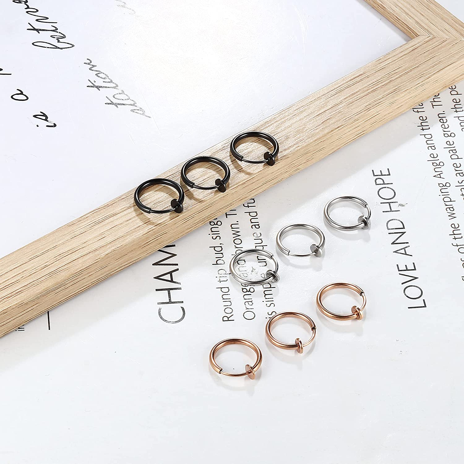 IRONBOX 9Pcs Fake Nose Rings Hoop Stainless Steel Retractable Nose Ring Clip On Spring Faux Lip Ring Faux Helix Cartilage Earrings Non Piercing Jewelry for Women Men