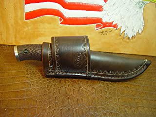 Custom cross draw knife sheath for the buck Selkirk knife. The sheath is made out of water buffalo hide leather.
