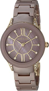 Anne Klein AK/2388MVGB Reloj de pulsera de cerámica con cristales Swarovski, tono dorado y malva para mujer