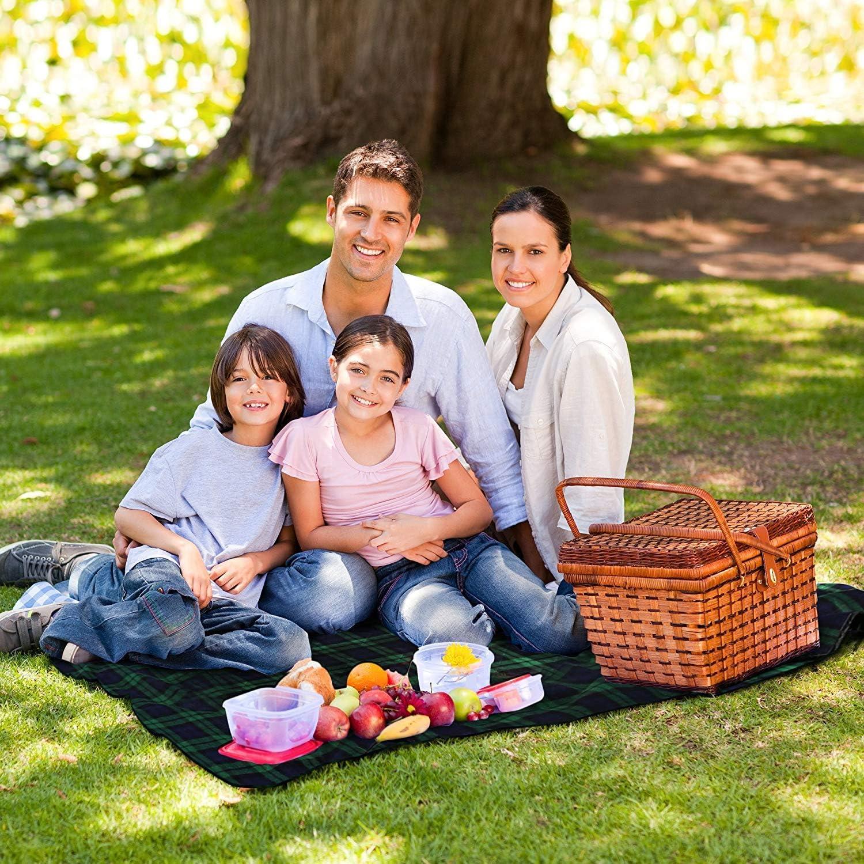 family sitting on KAMUI picnic blanket