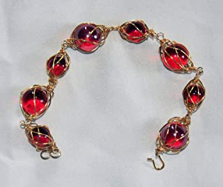 red and gold caged marble bracelet