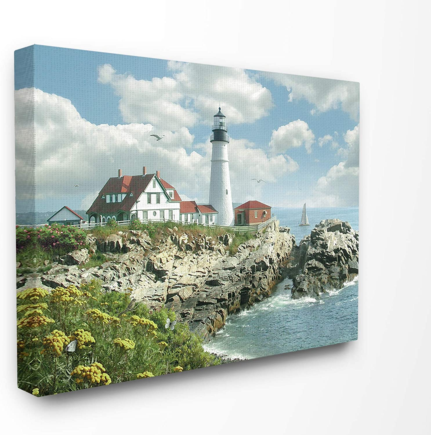 The Stupell Home Decor Portland Head Lighthouse Scene Grassy Ocean Side Peninsula with Sail Boat Stretched Canvas Wall Art, 11x14, Multi-color
