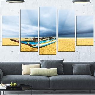 Designart MT14811-373 Fishing Boat on Beach with Dark Clouds - Large Seashore Glossy Metal Wall Art,Blue,60x32