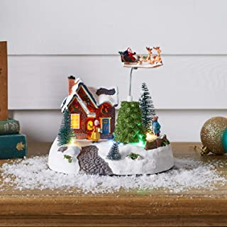 Lights4fun, Inc. Battery Operated LED Light Up Christmas Village Decoration with Rotating Santa & Sleigh