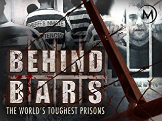 behind iron bars