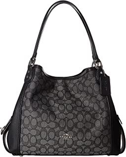 6864574b96 Coach madison maggie shoulder bag in op art sateen fabric silver ...
