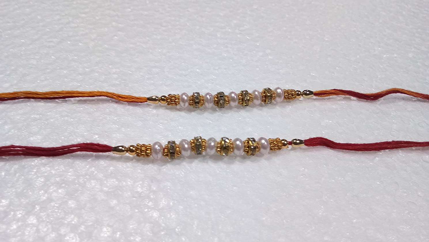 Set of Two Rakhi, White Moti Thread. Rakhi, Raksha Bandhan Multi Color Bedas & Stone Yellow and Orange Color Threads