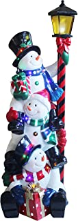 Fraser Hill Farm Indoor/Covered Outdoor Oversized Christmas Decoration, 4-Ft. Musical Stacking Snowman Trio with Lamp Post and LED Lights, Multi