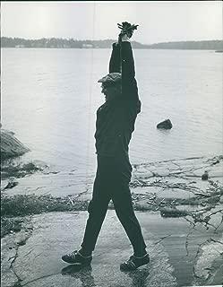 Vintage photo of Urho Kaleva Kekkonen stretching at shore. Photo taken on October 18, 1962.