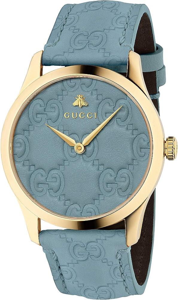 Gucci, orologio unisex g timless, cassa in pvd oro, e cinturino e quadrante in tessuto supreme fluorescente YA1264097