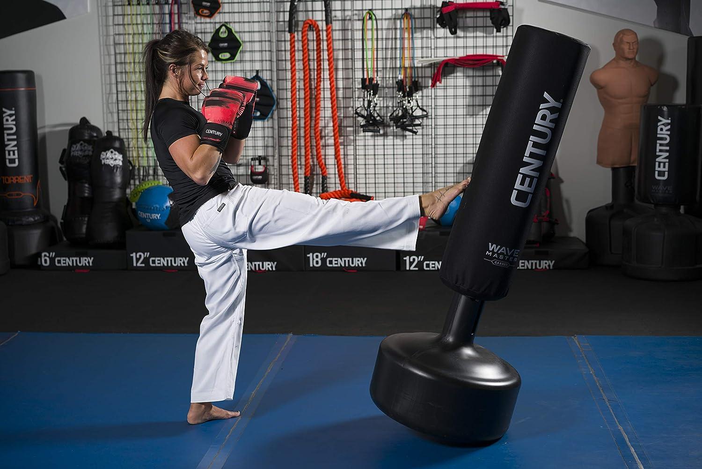 woman kicking aerobic Wavemaster punching bag