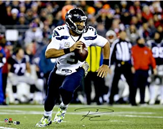 """Russell Wilson Seattle Seahawks Autographed 16"""" x 20"""" White Jersey Run Photograph - Autographed NFL Photos"""