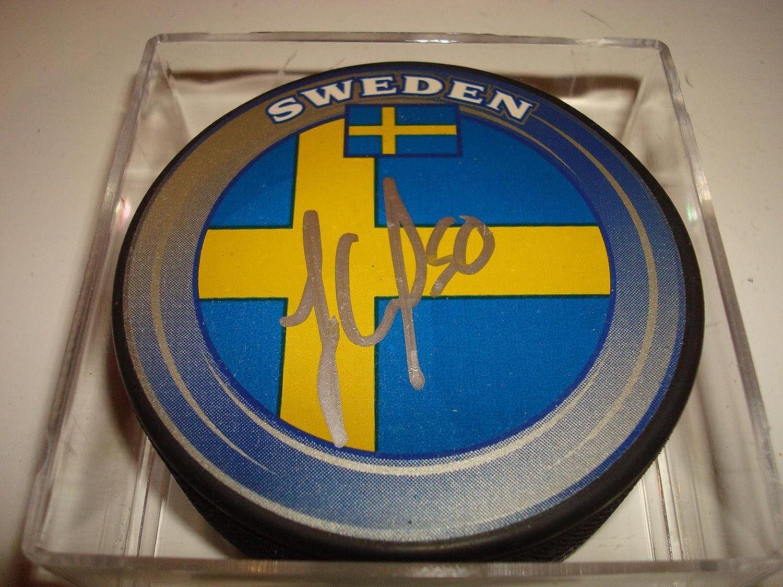 Autographed Jonas Gustavsson Puck  Team Sweden  2  Autographed NHL Pucks