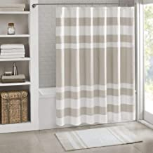 beige and white shower curtains
