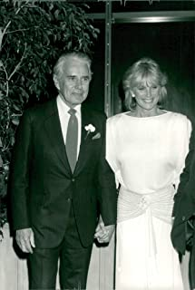 Vintage photo of John Forsythe and Linda Evans keep a happy hand during the gala celebrating Dynasty's perfume deal