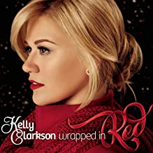"Deluxe Edition of Wrapped in Red includes two bonus tracks: ""I'll Be Home For Christmas"" and ""Oh Come, Oh Come Emmanuel."" ..."
