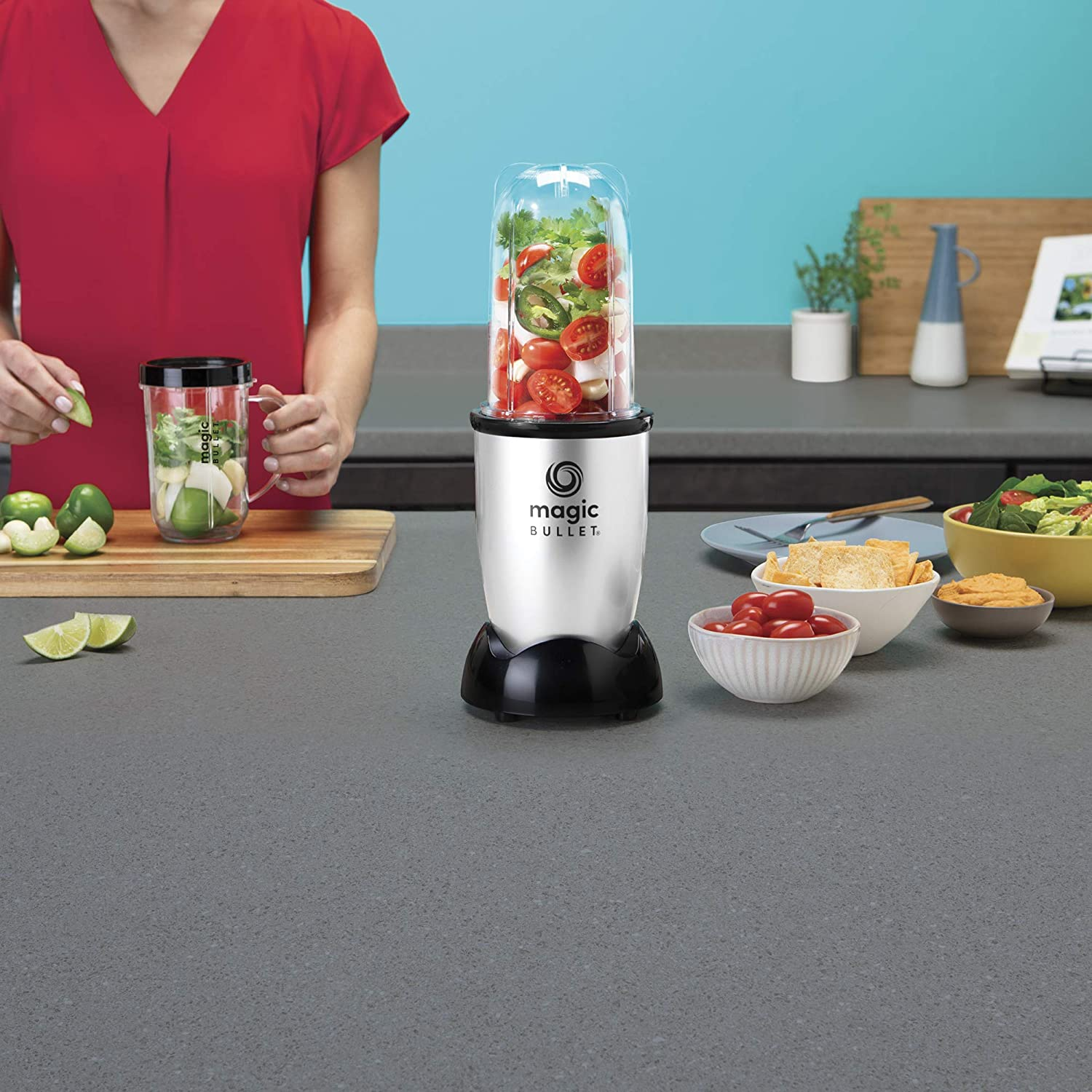 A lady doing blending with Ambiano Professional Blender Review (Magic Bullet)