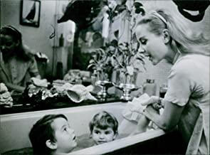 Vintage photo of A photo of French actress with a film career spanning fifty years Genevieve Page is bathing her kids.