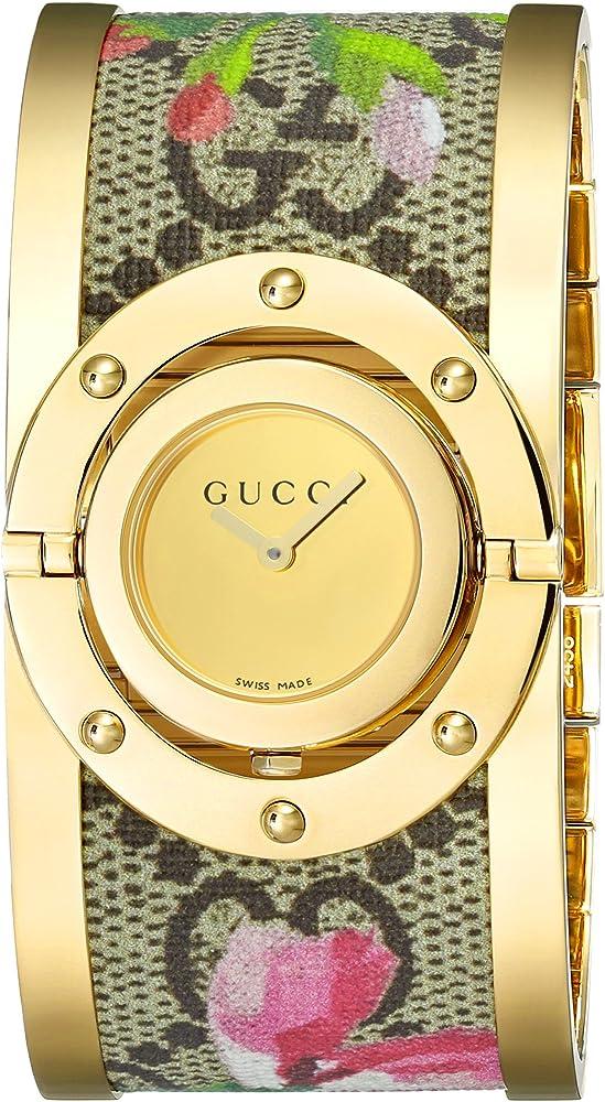 Gucci, orologio per donna, in acciaio e tessuto, con quadrante mobile che si trasforma in bracciale YA112443