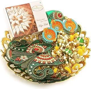 Ghasitaram Gifts Indian Sweets - Diwali Gifts Diwali Hampers-Golden Carved Basket Hamper of Kaju Katli,Toran, Rangoli and a Set of 6 Diyas