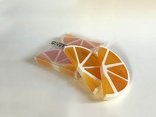 Jabón artesanal con aceites esenciales en forma de naranja