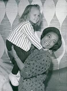Vintage photo of Eartha Kitt with daughter Kitt during a press reception
