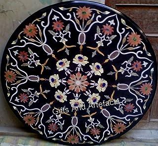 Mesa de comedor de mármol negro con piedras preciosas incrustadas en la parte superior de la mesa de restaurante con aspec...