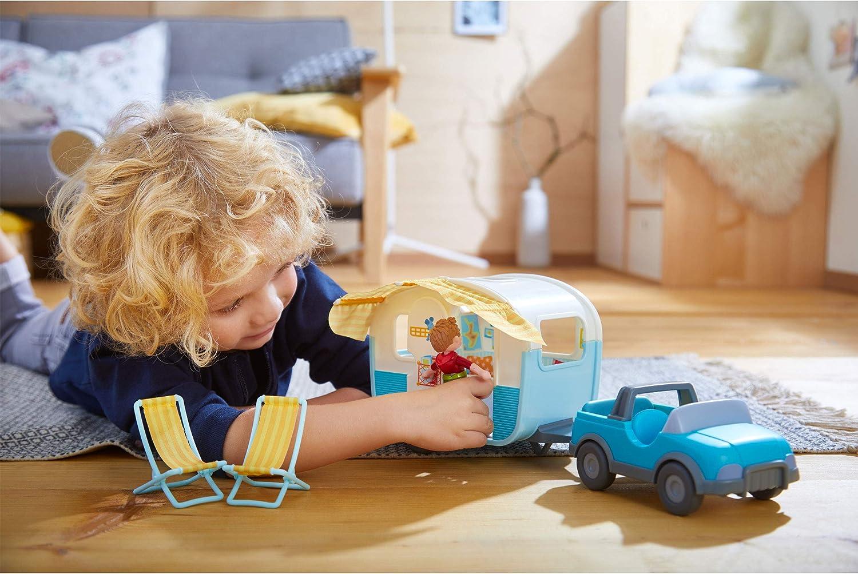Haba Little Friends Camper - Little kid setting it up