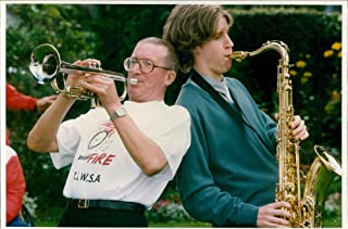 Vintage photo of Roy Castle, former English entertainer with his son Benjamin plays trumpet