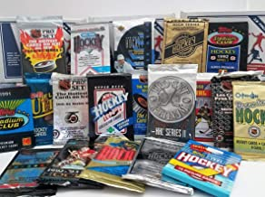 Over 200 Vintage Hockey cards in 20 Vintage Unopened Hockey Wax Packs from various brands from the 80's & 90's. Guaranteed one AUTOGRAPH or MEMORABILIA card per box! Great for 1st time collectors!
