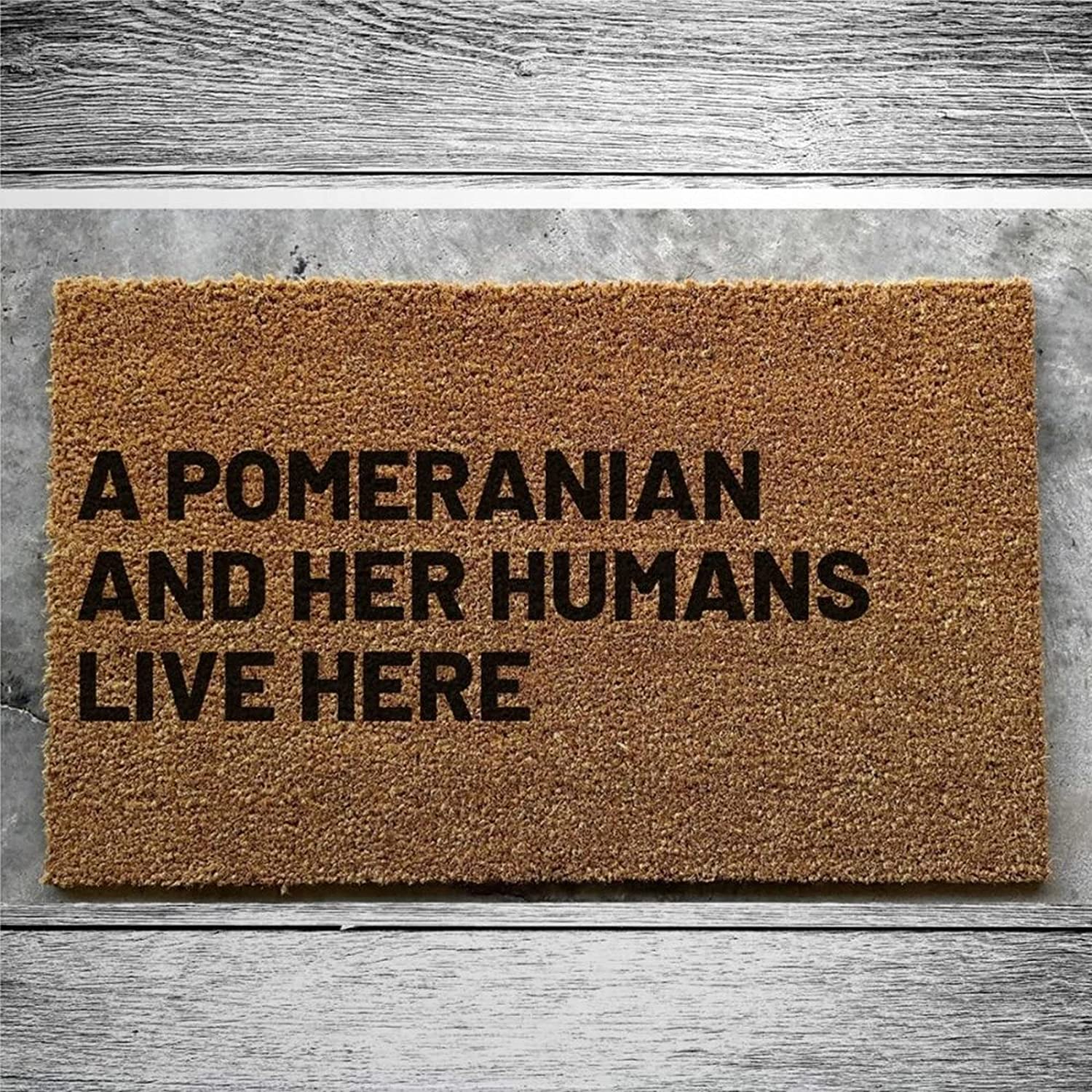 A Pomeranian and Her Sale special price Humans Live Here Doormat Outlet SALE Coir W Rustic Door