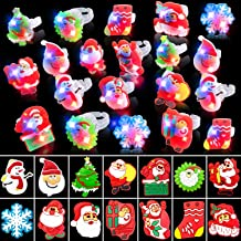 TURNMEON 50Pack LED Light Up Ring Christmas Party Favors for Kids Flashing Glow in The Dark Funny Christmas Party Supplies...