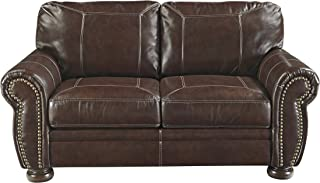 Ashley Furniture Signature Design - Banner Traditional Style Faux Leather Loveseat with Nailhead Trim - Coffee