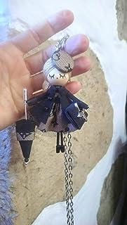 Spilla y collana da bambola:Collezione