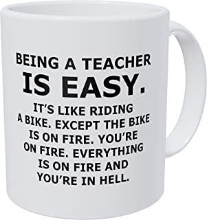 Wampumtuk Being A Teacher Is Easy, It's Like Riding A Bike On Fire And You're In Hell 11 Ounces Funny Coffee Mug