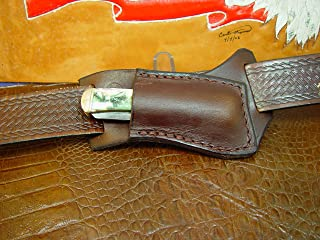 Custom Made Right Hand Cross Draw Knife Sheath for a 4 1/8 Inch Trapper Style Knife Made Out of 10 Ounce Water Buffalo Hide Died Dark Brown Knife Not Included Sheath Only.