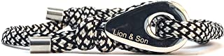 Bracciale in acciaio inox con ciondoli in pelle e paracord, regolabile.