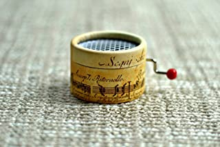 Music Box decorated with music writting with the song La vie en Rose in a hand cranked mechanisms