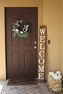 tall wooden welcome sign