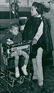Vintage photo of Eartha Kitt with her little daughter Kitt at the airport