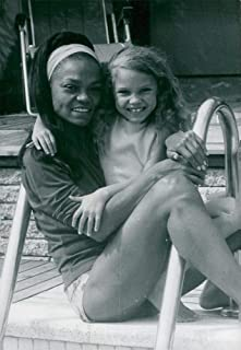Vintage photo of Eartha Kitt with his little daughter at the pool