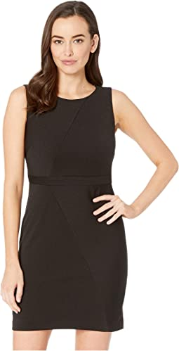 Daphne Ottoman Sleeveless Sheath Dress with Jewel Neckline and Mitered Seam Details.
