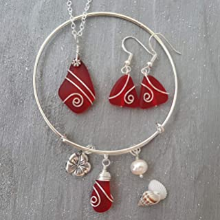 """product image for Wire Wrapped Ruby Red sea glass necklace + earrings + bracelet Set,""""July Birthstone"""", HIbiscus Charm, Freshwater pearl, (Hawaii Gift Wrapped, Customizable Gift Message)"""