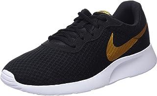 fe08bd5bf311 Nike Women s Tanjun Running Sneaker Black Metallic Gold 9.5